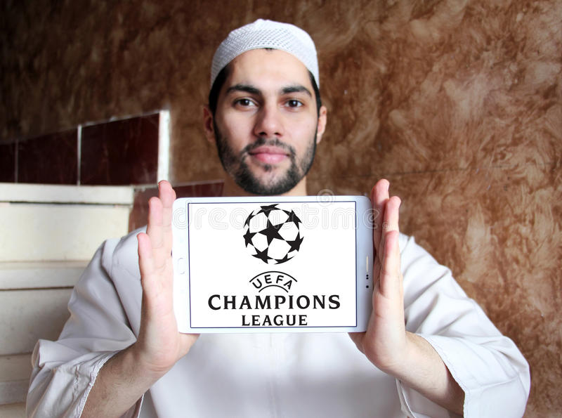 Uefa champions league logo. Logo of uefa champions league on samsung tablet holded by arab muslim man royalty free stock images