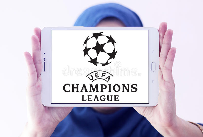 Uefa champions league logo. Logo of uefa champions league on samsung tablet holded by arab muslim woman stock photo