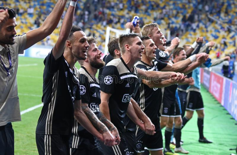 UEFA Champions League play-off: FC Dynamo Kyiv v Ajax. KYIV, UKRAINE - AUGUST 28, 2018: AFC Ajax players celebrate the reach of group stage after the UEFA royalty free stock image