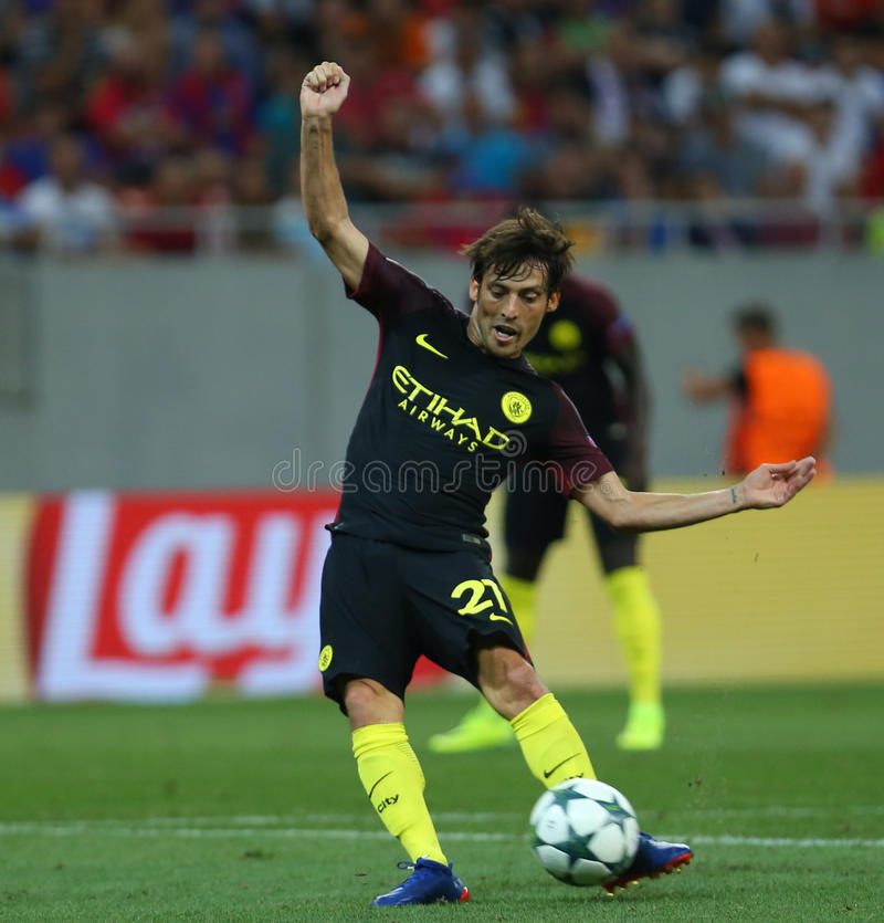 UEFA CHAMPIONS LEAGUE QUALIFICATION – STEAUA BUCHAREST vs. MANCHESTER CITY. Manchester City's David SIlva ( C ) in action during the UEFA Champions royalty free stock photo