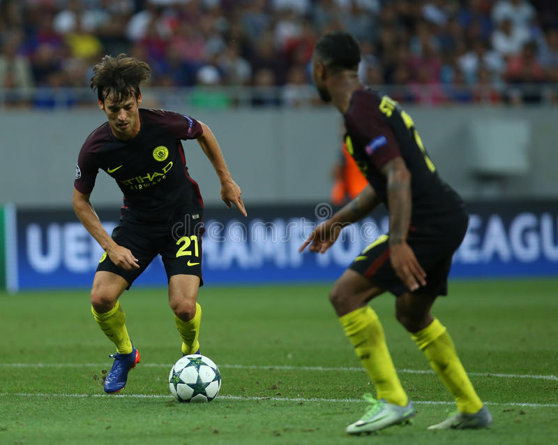 UEFA CHAMPIONS LEAGUE QUALIFICATION – STEAUA BUCHAREST vs. MANCHESTER CITY. Manchester City's David SIlva L in action during the UEFA Champions royalty free stock photography