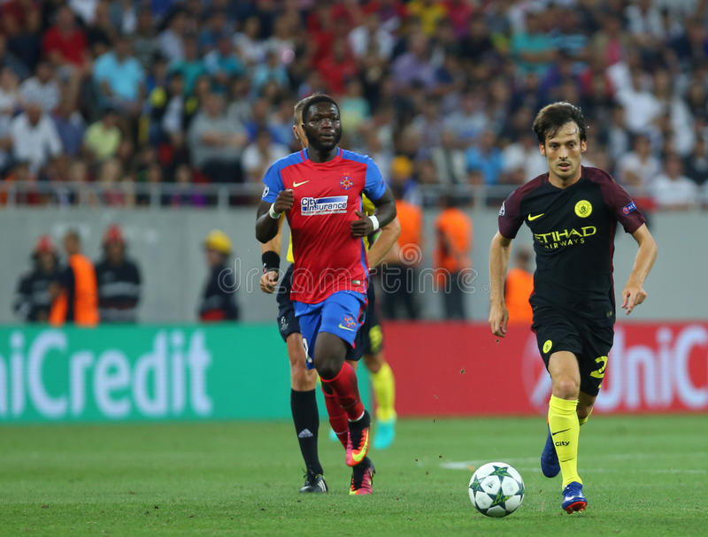 UEFA CHAMPIONS LEAGUE QUALIFICATION – STEAUA BUCHAREST vs. MANCHESTER CITY. Manchester City's David Silva ( R ) in action during the UEFA Champions royalty free stock photography