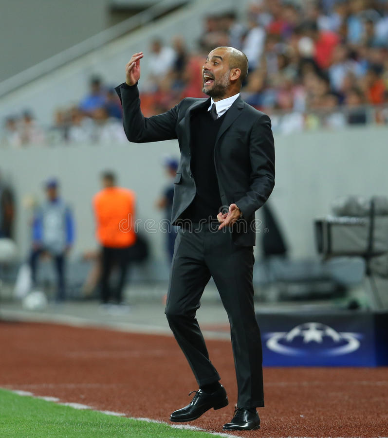 UEFA CHAMPIONS LEAGUE QUALIFICATION – STEAUA BUCHAREST vs. MANCHESTER CITY. Manchester City's head coach Pep Guardiola in action during the UEFA stock photos