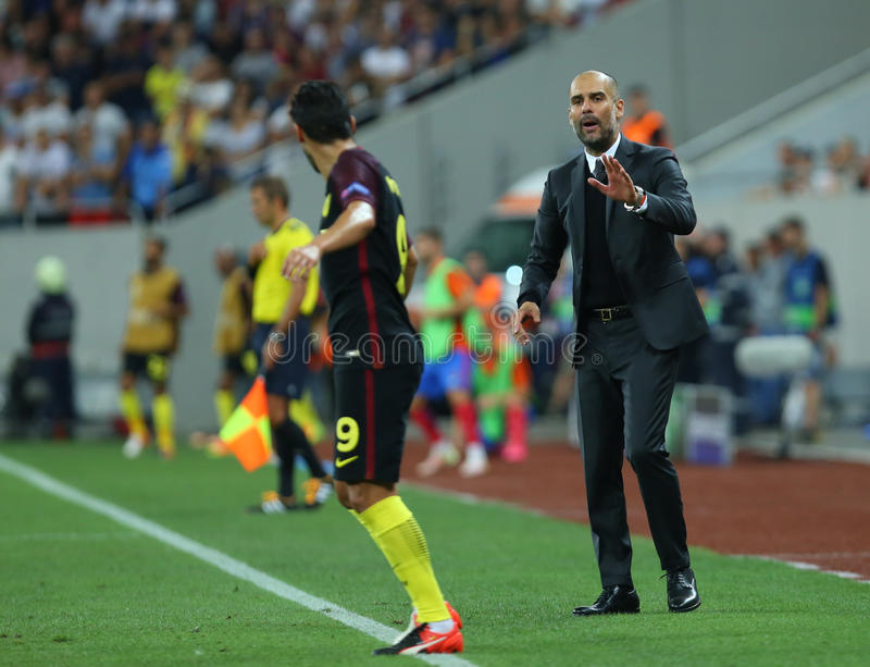 UEFA CHAMPIONS LEAGUE QUALIFICATION – STEAUA BUCHAREST vs. MANCHESTER CITY. Manchester City's head coach Pep Guardiola ( R ) in action during the stock photos