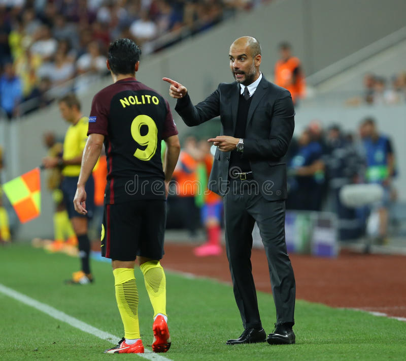 UEFA CHAMPIONS LEAGUE QUALIFICATION – STEAUA BUCHAREST vs. MANCHESTER CITY. Manchester City's head coach Pep Guardiola ( R ) in action during the stock images