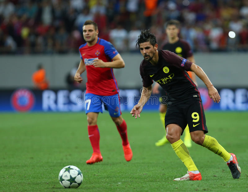 UEFA CHAMPIONS LEAGUE QUALIFICATION – STEAUA BUCHAREST vs. MANCHESTER CITY. Manchester City's Manuel Agudo Duran ''NOLITO'' ( R ) in action during royalty free stock photo