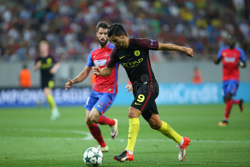 UEFA CHAMPIONS LEAGUE QUALIFICATION – STEAUA BUCHAREST vs. MANCHESTER CITY. Manchester City's Manuel Agudo Duran ''NOLITO'' ( R ) in action during royalty free stock photography