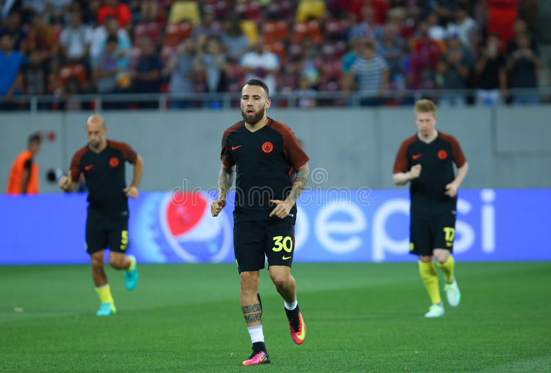UEFA CHAMPIONS LEAGUE QUALIFICATION – STEAUA BUCHAREST vs. MANCHESTER CITY. Manchester City's Nicolas Otamendi C in action at warm-up before the stock photo