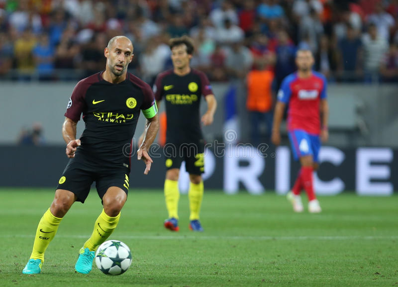 UEFA CHAMPIONS LEAGUE QUALIFICATION – STEAUA BUCHAREST vs. MANCHESTER CITY. Manchester City's Pablo Zabaleta ( L ) in action during the UEFA stock image