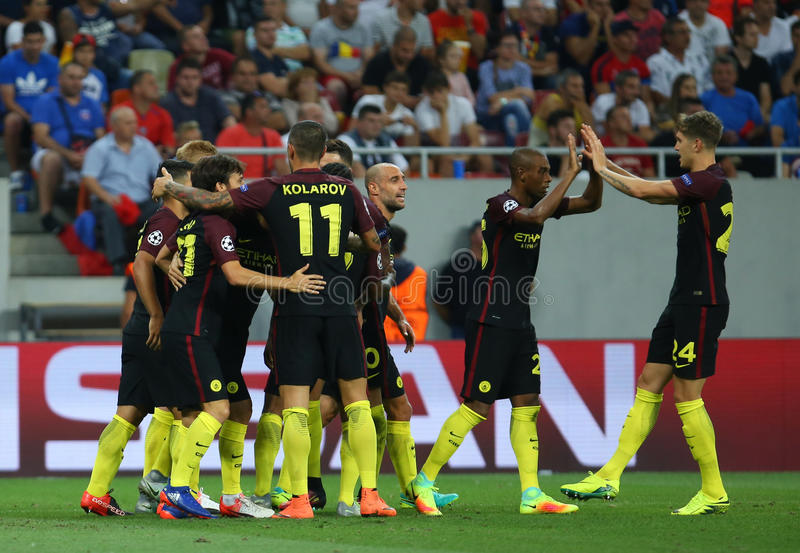 UEFA CHAMPIONS LEAGUE QUALIFICATION – STEAUA BUCHAREST vs. MANCHESTER CITY. Manchester City's players celebrates after scoring during the UEFA royalty free stock photos