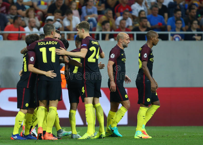 UEFA CHAMPIONS LEAGUE QUALIFICATION – STEAUA BUCHAREST vs. MANCHESTER CITY. Manchester City's players celebrates after scoring during the UEFA royalty free stock photo
