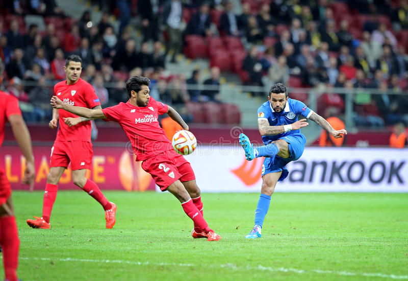 UEFA Europa League Final football game Dnipro vs Sevilla. WARSAW, POLAND - MAY 27, 2015: Matheus of FC Dnipro (R) fights for a ball with Benoit Tremoulinas of FC royalty free stock photo