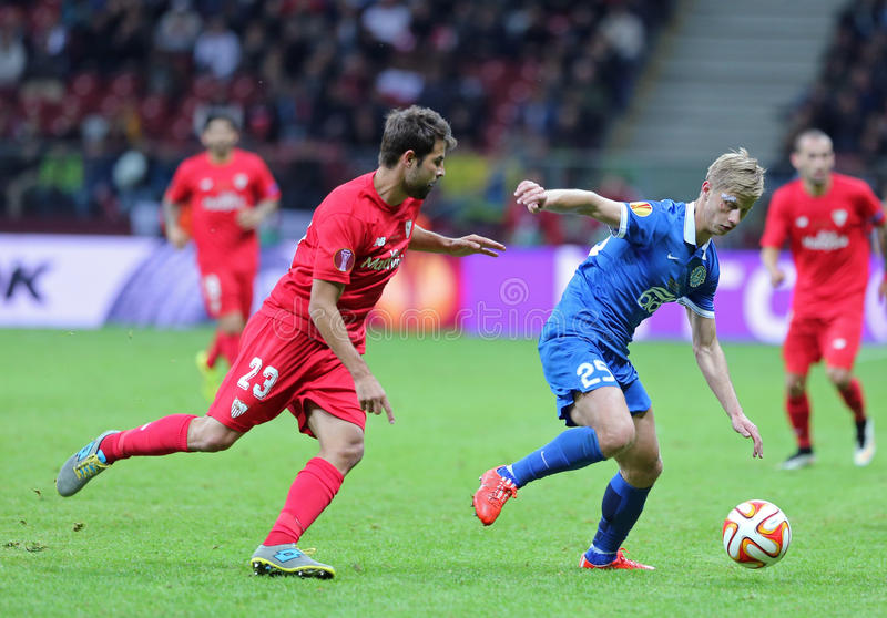 UEFA Europa League Final football game Dnipro vs Sevilla. WARSAW, POLAND - MAY 27, 2015: Valeriy Fedorchuk of FC Dnipro (R) fights for a ball with Coke of FC stock photography