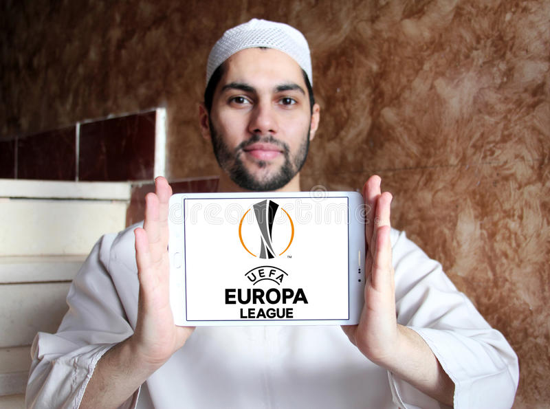 Uefa europa league logo. Logo of uefa europa league on samsung tablet holded by arab muslim man stock photo
