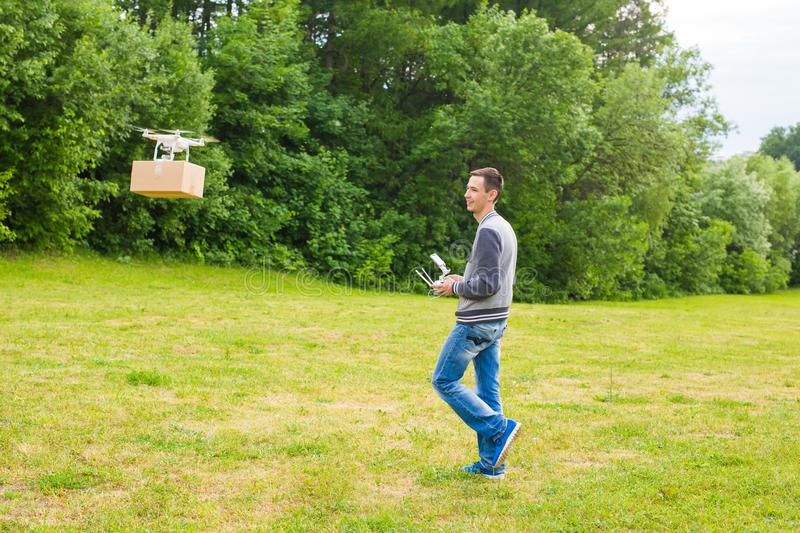 Ufa, Russia. - 6 June 2016 : Air drone carrying cardboard box - concept image of futuristic delivery drone. royalty free stock images