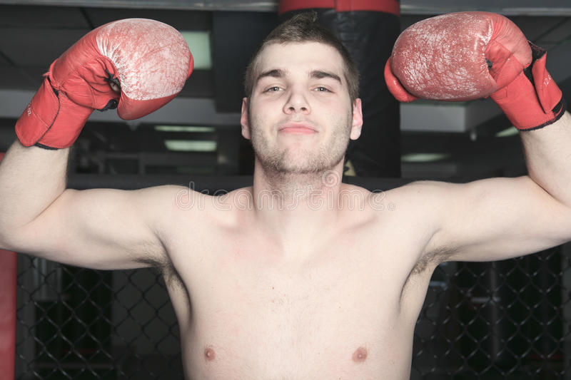 UFC Fighter. An Athlete with boxing glove show is muscle stock image