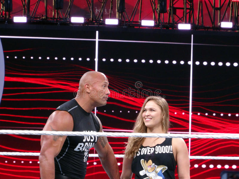 UFC star and Bantamweight Champion Ronda Rousey and the Rock celebrate in the ring royalty free stock photo