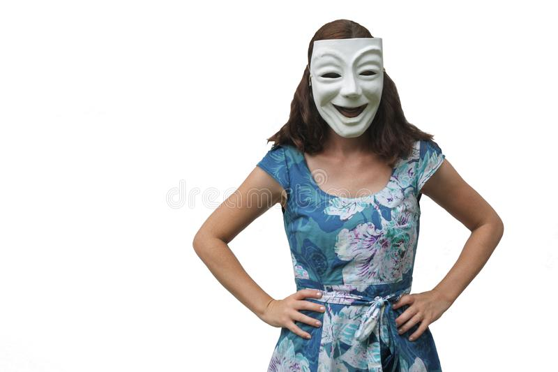 Ufna kobieta jest ubranym szczęśliwą twarzy maski pozycję z rękami przy zdjęcia royalty free