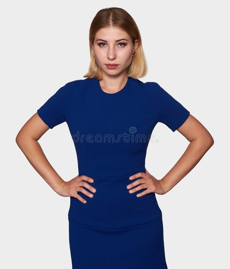 Ufna młoda ładna kobieta w błękit sukni zdjęcie royalty free