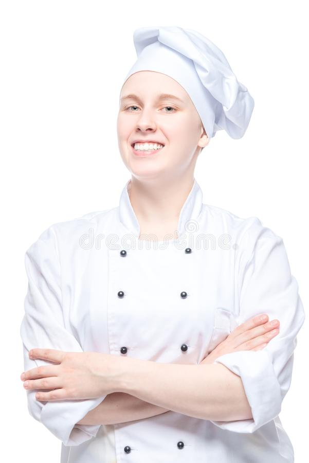ufny kobieta szef kuchni w jednolitym portrecie na bielu obrazy stock
