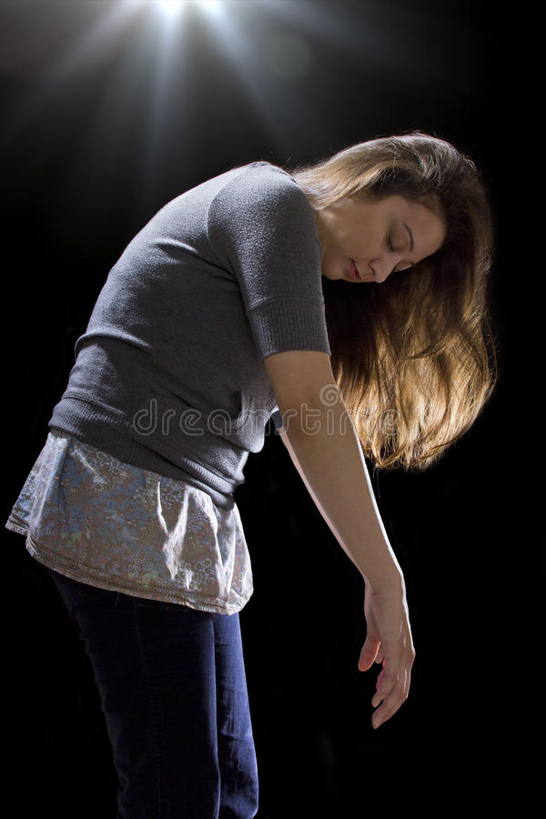 UFO Abduction. Young woman being abducted by UFO royalty free stock photos