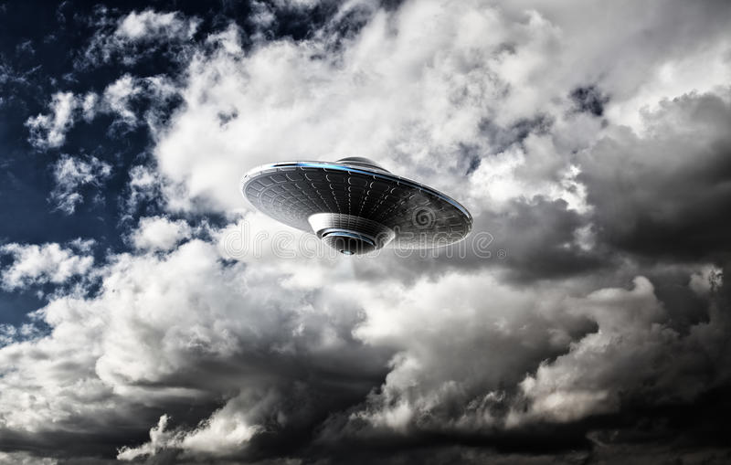 UFO. In the cloudy sky stock photography