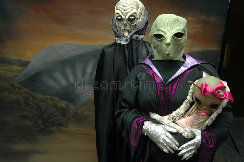 Ufo festival. An alien family pose for a photograph in Roswell, NM on Friday, July 6, 2007 during the UFO Festival royalty free stock images