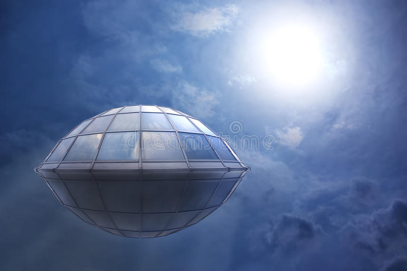UFO flies in the cloudy sky. To the sun royalty free stock image