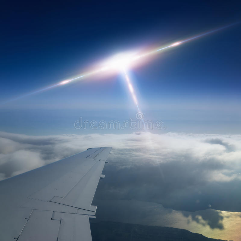 Ufo flies near airplane. Abstract scientific background - flying craft piloted by aliens approaches to aircraft, ufo flies near airplane royalty free stock images