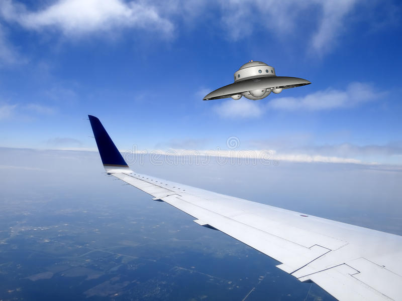 UFO Flying Saucer Sighting. A UFO sighting or unidentified flying object. The flying saucer is above the earth and clouds going through a blue sky. Watch out for stock photo