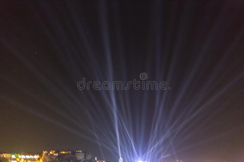 UFO with light rays landing in a city royalty free stock photo
