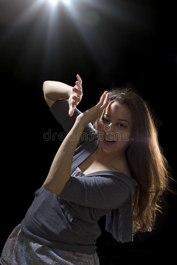 UFO Sighting. Young woman seeing bright glowing orbs from above royalty free stock photo