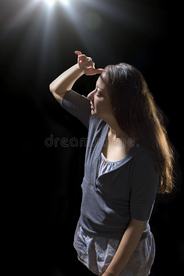 UFO Sighting. Young woman seeing bright glowing orbs from above royalty free stock image