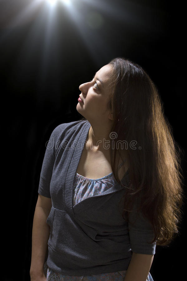 UFO Sighting. Young woman seeing bright glowing orbs from above royalty free stock images