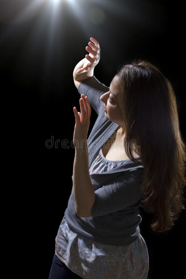 UFO Sighting. Young woman seeing bright glowing orbs from above stock images