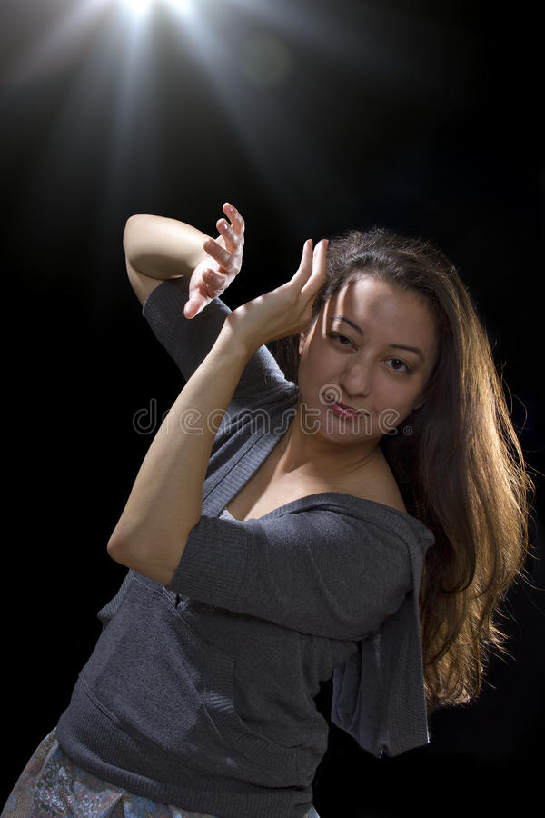 UFO Sighting. Young woman seeing bright glowing orbs from above stock photography