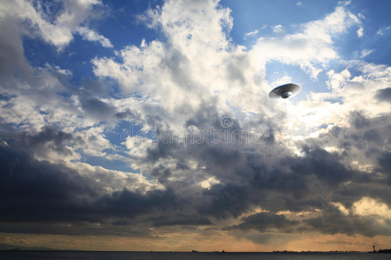 UFO in the sky. An imaginary UFO is modelled and rendered royalty free stock photo