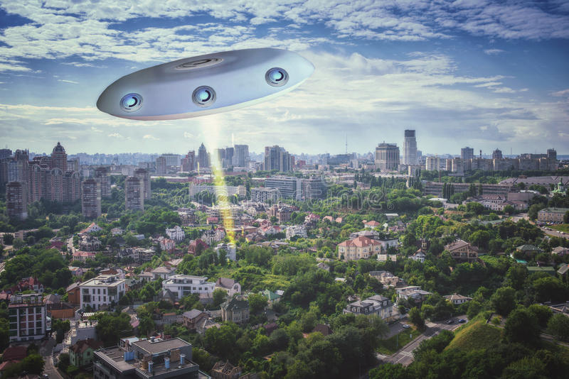 UFO in the sky. Over the city stock photo