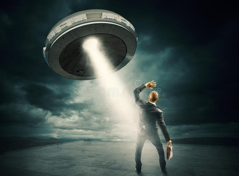 UFO space shuttle. Frightened man by the UFO space shuttle royalty free stock photography