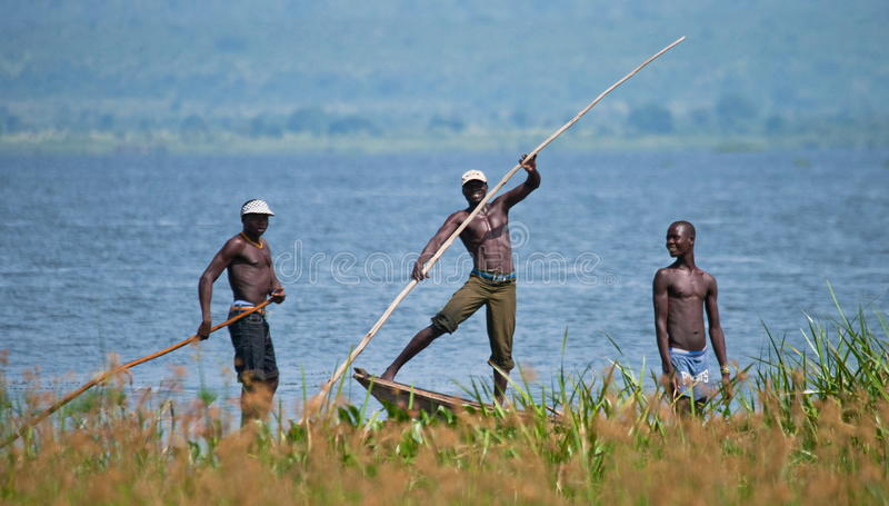 Uganda. Fishermen from the village fishing on the White Nile. stock photo