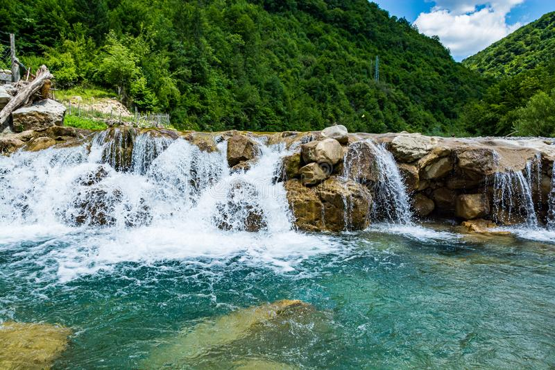 Ugar river with small water cascade near village Donji Orasac in Bosnia and Herzegovina.  royalty free stock images