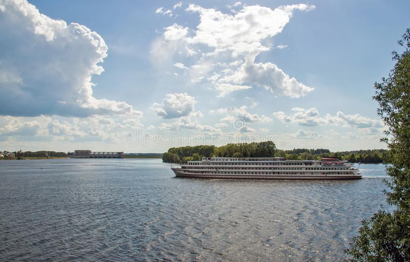 Uglich. Cruise ship on the Volga. Uglich hydroelectric power station royalty free stock photo