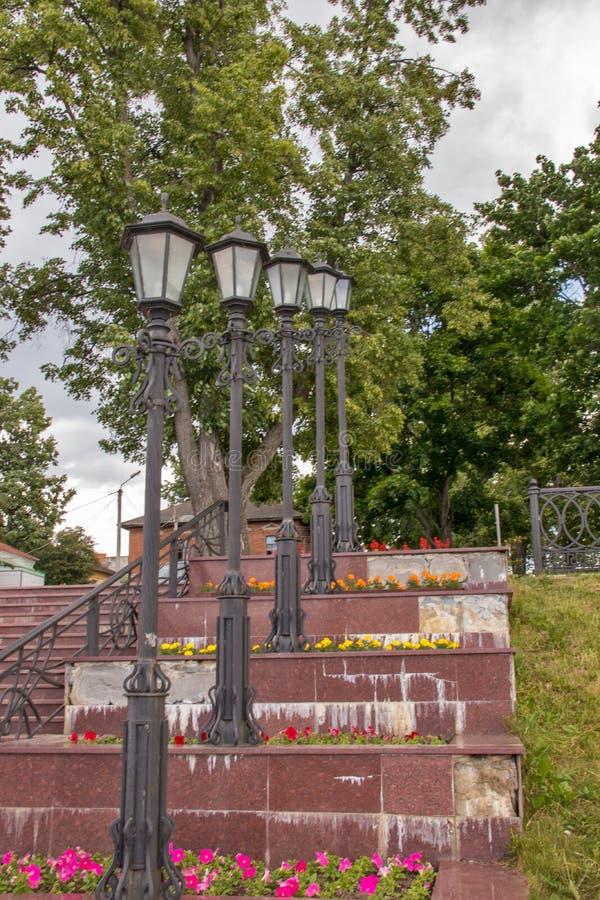 Uglich. The Volga River Embankment. A slender row of beautiful lanterns. Rhythm. Prospect. Travel; Golden ring stock images