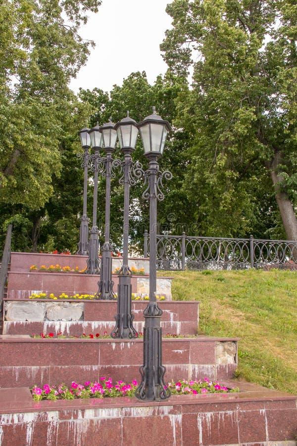 Uglich. The Volga River Embankment. A slender row of beautiful lanterns. Rhythm. Prospect. Travel; Golden ring stock image