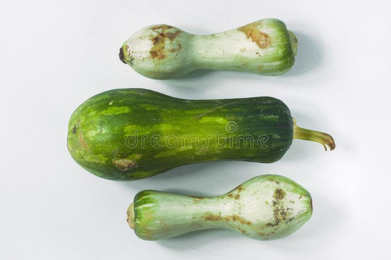 Ugly food concept. Unusual shaped zucchini with mold, scar-like structure, scratches. Top view. Ugly food concept. Unusual shaped zucchini with mold, scar-like stock photo