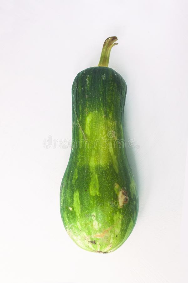 Ugly food concept. Unusual shaped zucchini with mold, scar-like structure, scratches. Top view. Ugly food concept. Unusual shaped zucchini with mold, scar-like royalty free stock images
