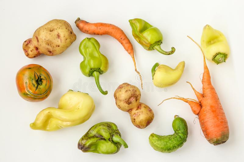 Ugly vegetables: potatoes, carrots, cucumber, peppers and tomatoes on white background, ugly food concept, horizontal photo, top stock photos