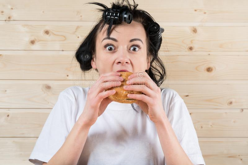 Ugly woman eating a burger stock image