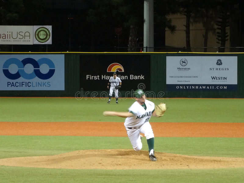 UH Pitcher Eric Gleese steps forward to throws side arm from th. HONOLULU, HI - APRIL 24: UH Pitcher Eric Gleese steps forward to throws side arm from the mound royalty free stock image