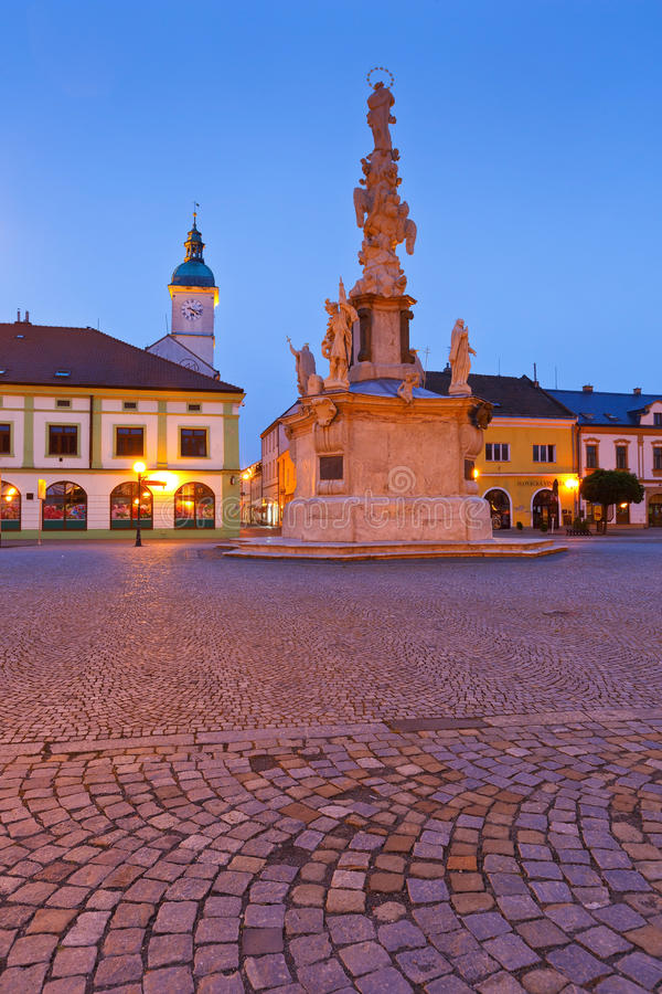 Uherske Hradiste, Czech Republic. Monument and the town hall tower in a square of the old town of Uherske Hradiste early in the morning royalty free stock photo